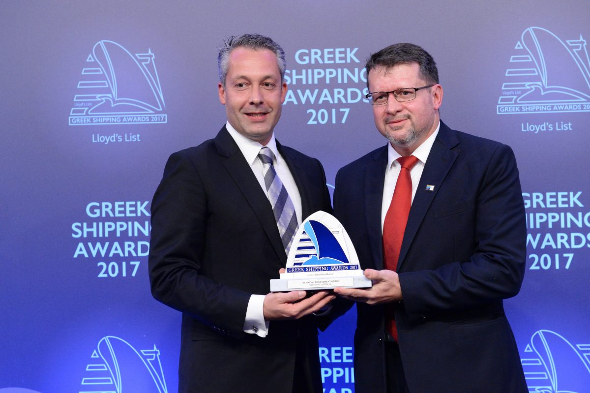 Dr. Ioannis Arabatzis founder & managing director of NanoPhos Marine accepting the Technical Achievement Award from Ioannis Chiotopoulos of sponsor DNV GL.