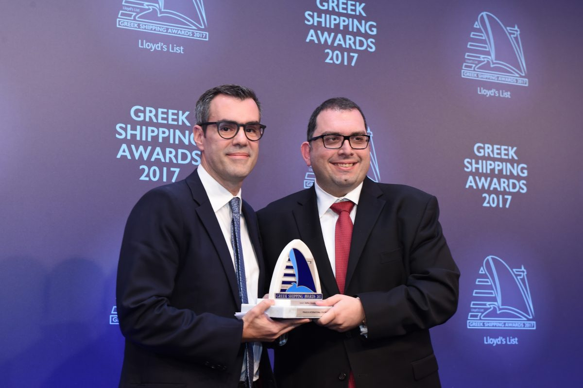 Dr. Ilias Bissias of Naftika Chronika accepting the Piraeus International Centre Award from John Laderos of sponsor SRH Marine Group.