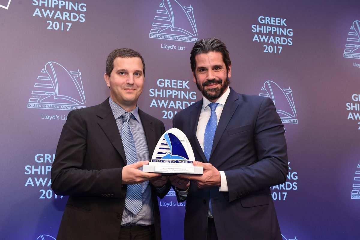 Ioannis Martinos accepting the Next Generation Shipping Award from Theofilos Xenakoudis of sponsor IRI/The Marshall Islands Registry.