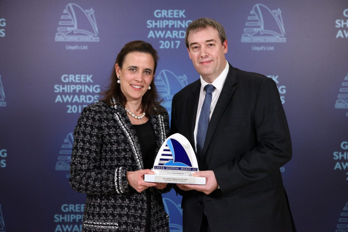 Tatiana Vourecas-Petalas accepting the Dry Cargo Company of the Year Award for Carras (Hellas) S.A. from Matthew More of sponsor Marichem Marigases.