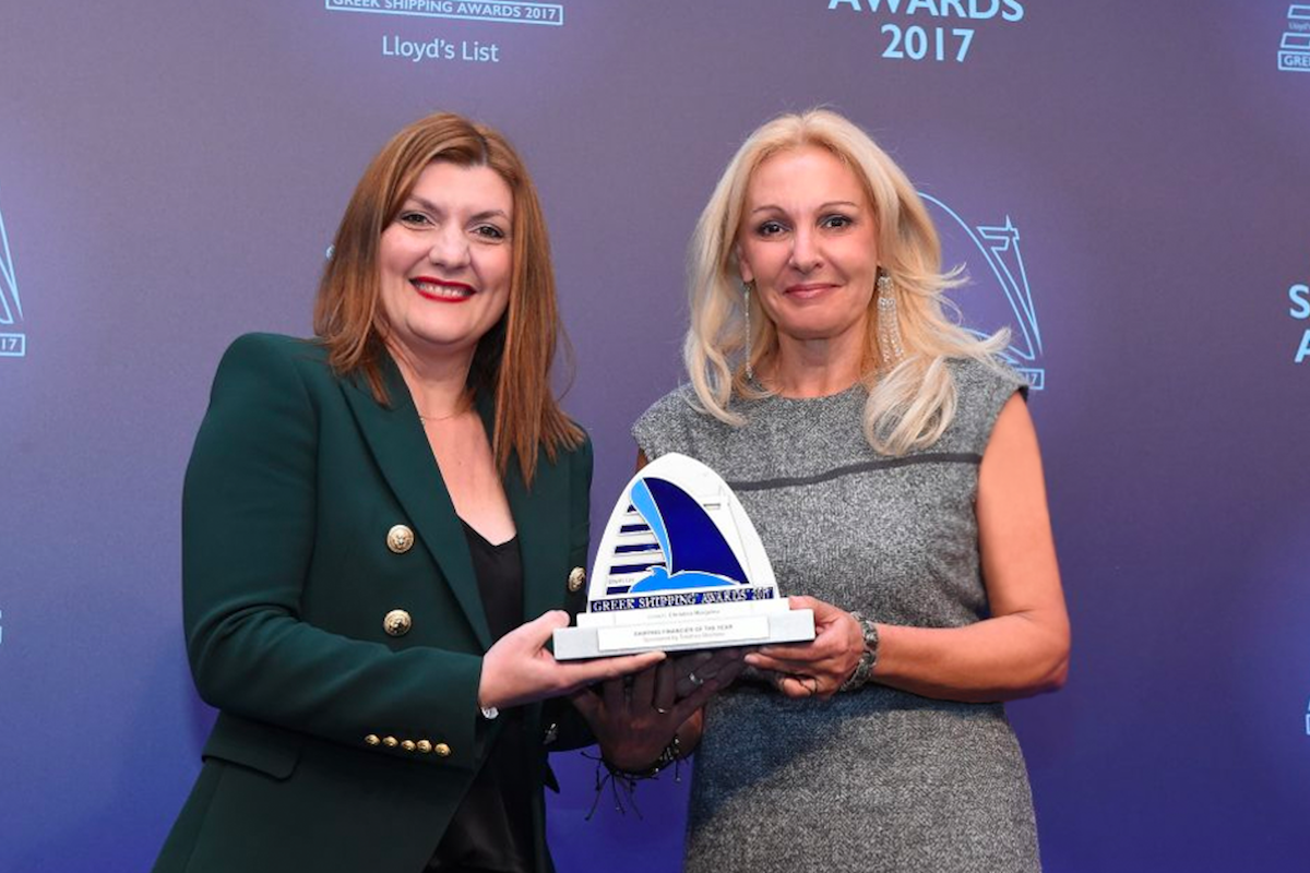 Despina Panayiotou-Theodosiou of sponsor Tototheo Maritime presenting the Shipping Financier of the Year Award to Christina Margelou of Eurobank.