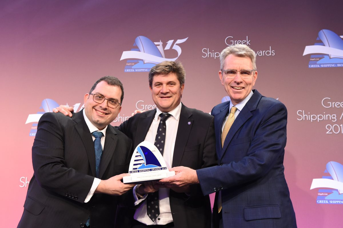 John Laderos of sponsor SRH Marine Group presenting the Piraeus International Centre Award for The Propeller Club, port of Piraeus to George Xiradakis (centre) and US Ambassador Geoffrey Pyatt.
