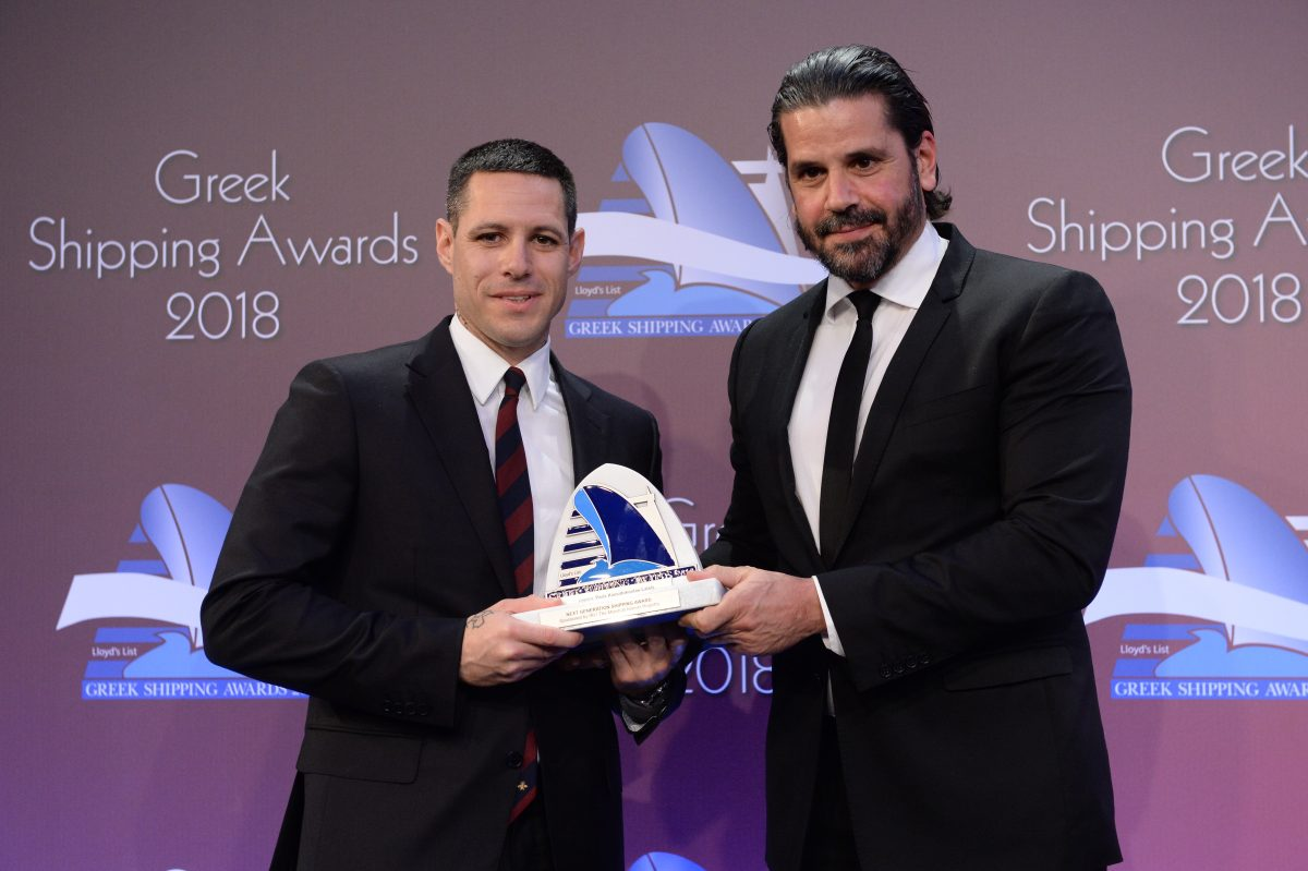 Paris Kassidokostas-Latsis accepting the Next Generation Shipping Award from Theofilos Xenakoudis of sponsor IRI/The Marshall Islands Registry