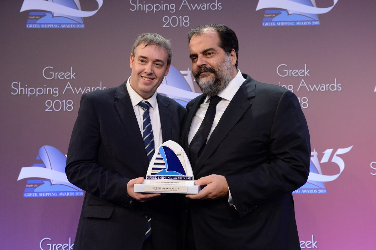 Nicolas D. Pateras (right) accepting the Dry Cargo Company of the Year Award for Contships Management Inc. from Matthew More of sponsor Marichem Marigases.